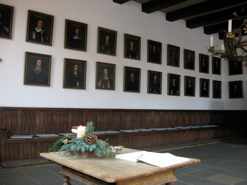 room with walls covered in portraits