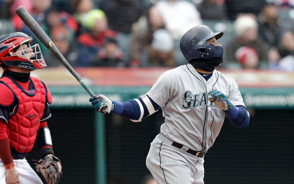 . Seattle Mariners\' Robinson Cano watches his ball after hitting a sacrifice fly in the third inning of a baseball game, Saturday, April 28, 2018, in Cleveland. Dee Gordon scored on the play. (AP Photo/Tony Dejak)