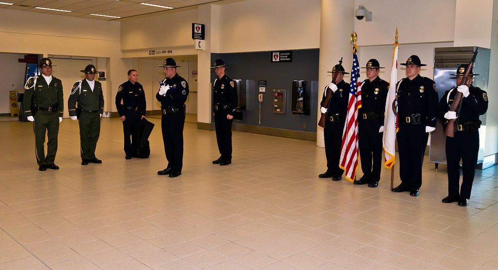 . The U.S. Honor Flag arrives at LA/Ontario International Airport for use at a funeral for a fallen law enforcement officer, Riverside Police Officer Michael Crain in Riverside, California Courtesy Photo