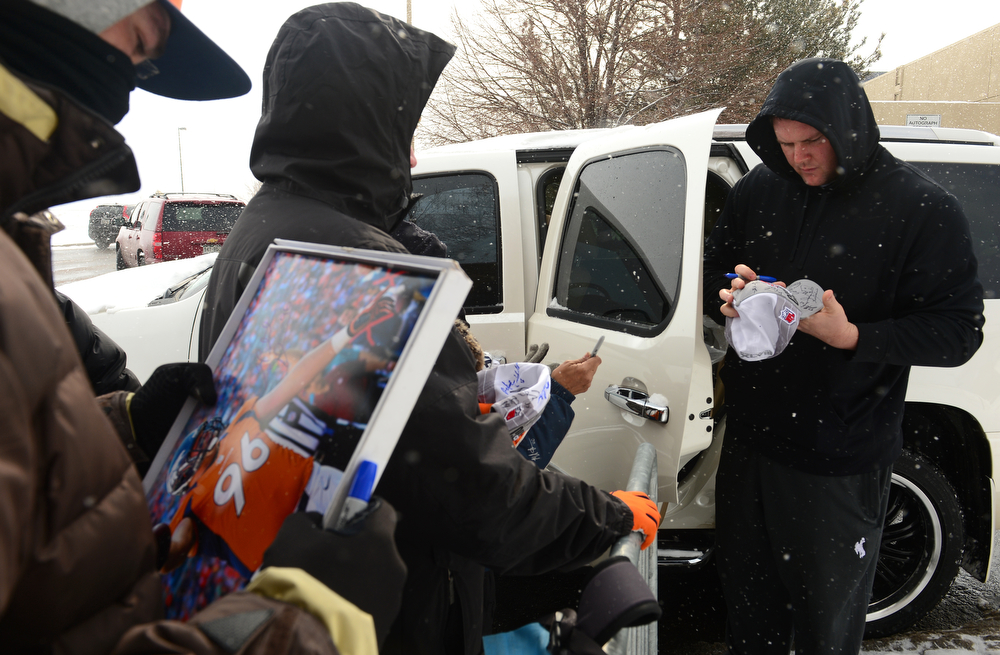 . Denver Broncos defensive tackle Mitch Unrein handed gloves, shoes and autographs to fans outside of Dove Valley as members of the team leave for the season in Englewood, Co on February 4, 2014. (Photo By Helen H. Richardson/ The Denver Post)