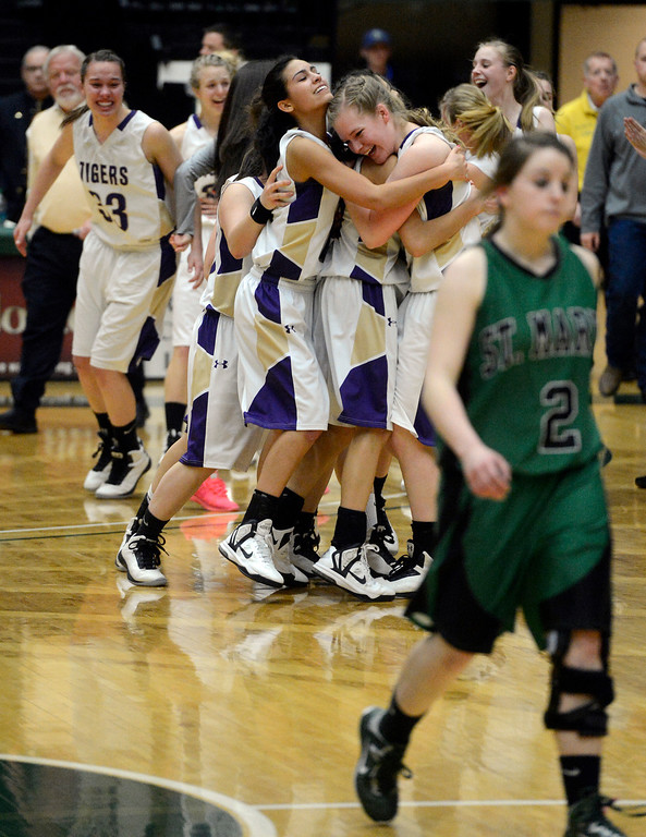 . FT. COLLINS, CO. - MARCH 16TH: The Holy Family Tigers celebrate their double overtime victory over Laura Broerman and the St. Mary\'s Pirates for the 3A Colorado State Championship game at Moby Arena Saturday evening, March 16th, 2013. (Photo By Andy Cross/The Denver Post)