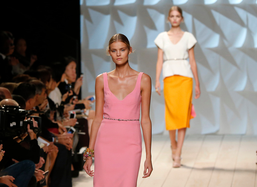 . Models wear creations for Nina Ricci\'s Spring/Summer 2015 ready-to-wear fashion collection, presented in Paris, France, Thursday, Sept. 25, 2014.  (AP Photo/Jacques Brinon)