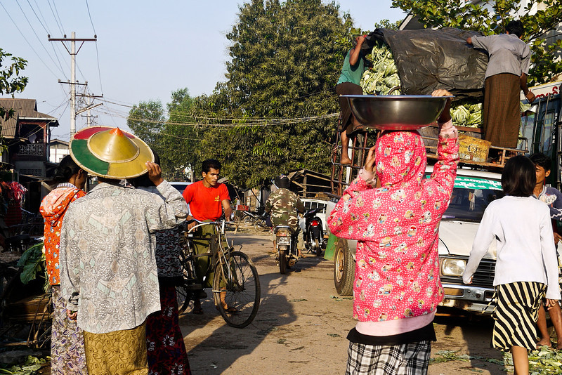 Morning shoppers and vendors take to the streets at the market in Hpa-An, Burma.