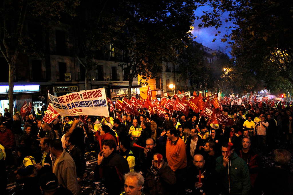 . Protestors march during a demonstration against layoffs of street cleaners and garbage collectors in Madrid, Spain, Monday, Nov. 4, 2013. Trash collectors in Madrid have started bonfires and set off firecrackers during a noisy protest in one of the Spanish capitalís main squares as they prepare to start an open-ended strike. (AP Photo/Francisco Seco)