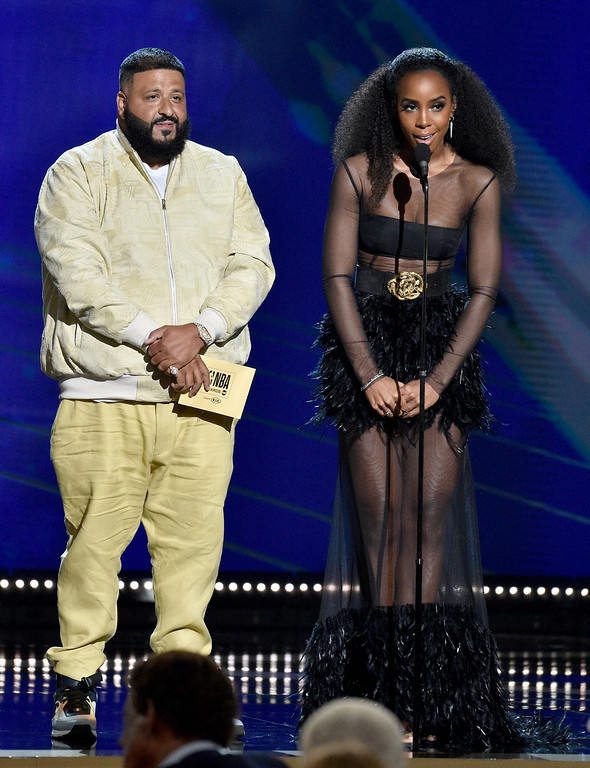 . DJ Khaled, left, and Kelly Rowland present the rookie of the year award at the NBA Awards on Monday, June 25, 2018, at the Barker Hangar in Santa Monica, Calif. (Photo by Chris Pizzello/Invision/AP)