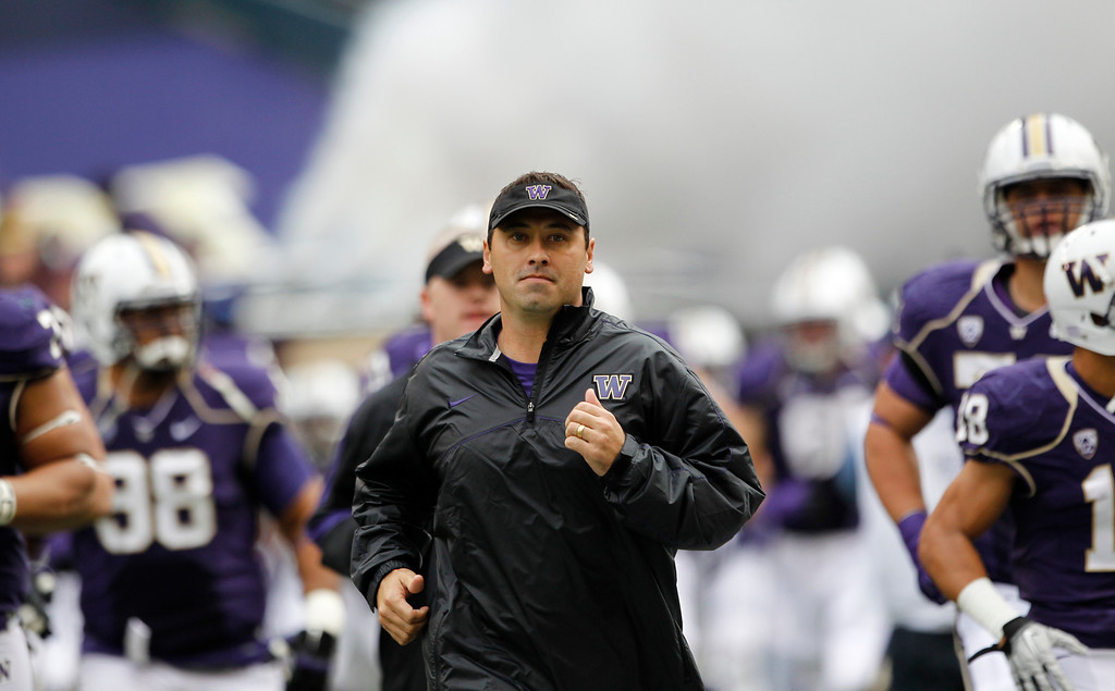 . Washington head coach Steve Sarkisian runs onto the field before the first half of an NCAA college football game against Southern California Saturday, Oct. 13, 2012, in Seattle. (AP Photo/Elaine Thompson)