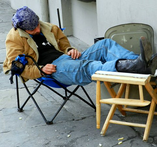 03-02-12 A NOLA local takes a mid morning nap on Rue Royal