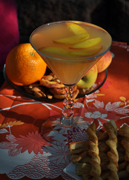 Photograph of Perfect Peach iS Martini, a soft Summer Cocktail from iS Vodka, refreshing summer drink made with iS Vodka, white peach puree and Saint Germain. Recipe for  Perfect Peach iS Martini 1.5 oz of iS Vodka, .75 oz of Saint Germain, 1 oz of White Peach Puree and a float of champagne.