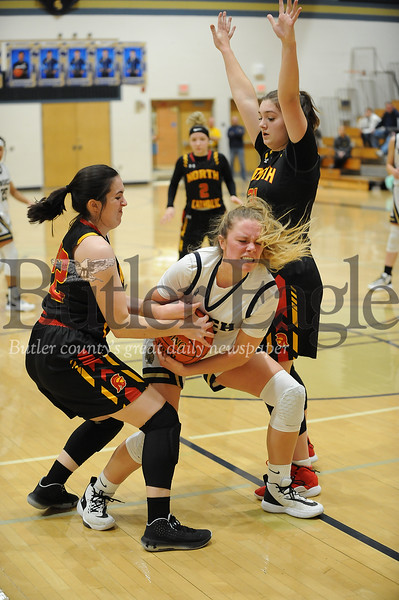Knoch #42 Lauren Cihonski holds the ball against North Catholic #22 Lucy Waskiewiez and #31 (not on roster) during a game at Knoch Gym on Monday January 13, 2020 (Jason Swanson photo)