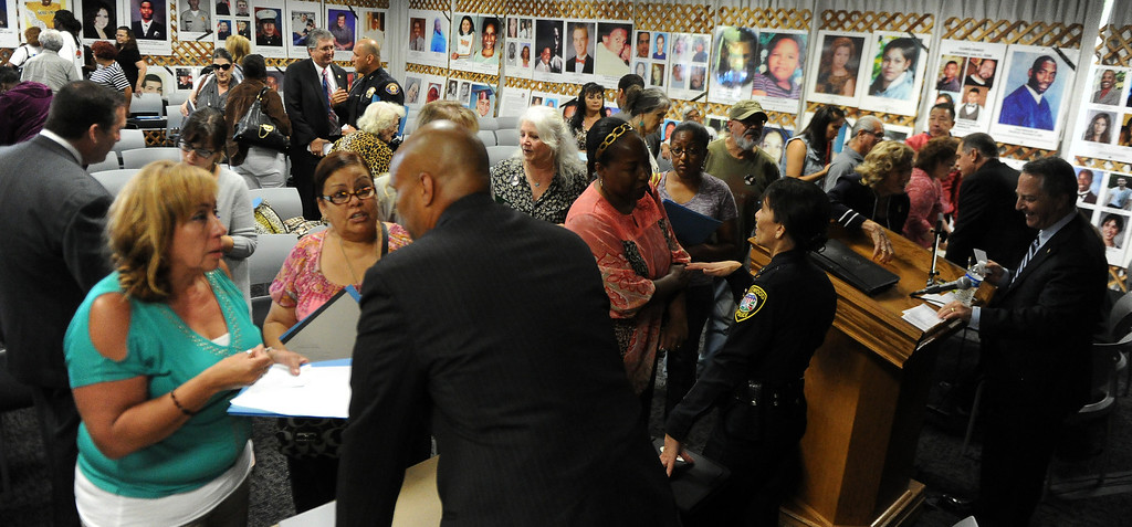 . Victims families speaks to officials during a Los Angeles County Sheriff�s Department and Justice for Murdered Children unsolved homicide summit at the Los Angeles County Sheriff\'s headquarters on Saturday, July 20, 2013 in Monterey Park, Calif.  (Keith Birmingham/Pasadena Star-News)