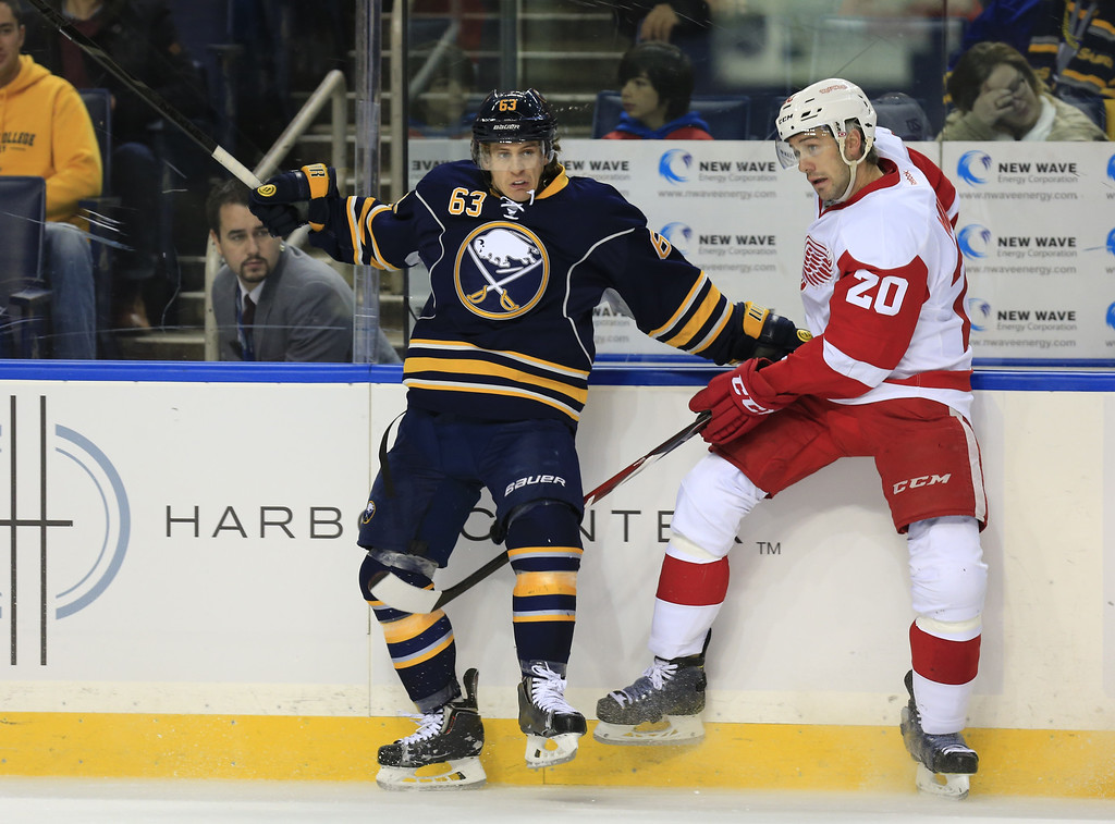 . Buffalo Sabres Tyler Ennis (63) checks Detroit Red Wings player Drew Miller (20) during first period action of an NHL hockey game, Sunday, Nov. 2, 2014, in Buffalo, N.Y. (AP Photo/The Buffalo News, Harry Scull Jr)
