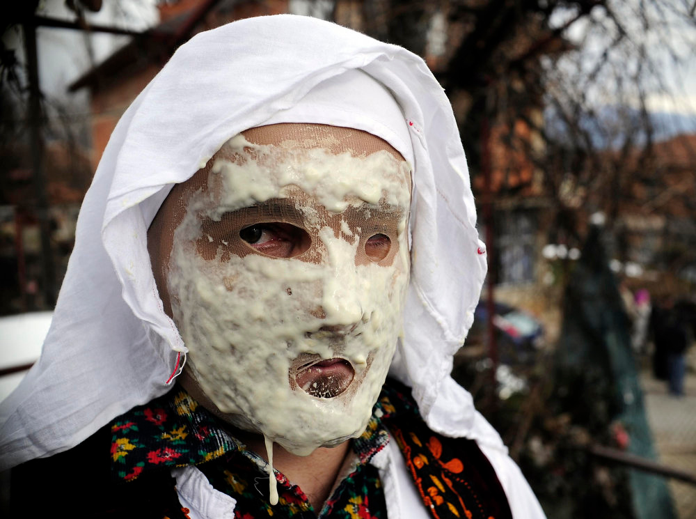 Description of . A reveler poses before parading the streets during a carnival in the village of Vevcani, some 170 km (106 miles) from the Macedonian capital Skopje, January 13, 2013. Vevcani village marks the Orthodox St. Vasilij Day annually with a carnival that features a 1,400-year-old celebration with pagan roots. The highlights of the carnival include a political satire where masked villagers act out current events.  REUTERS/Ognen Teofilovski