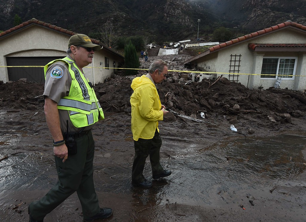 . Houses are damaged on San Como Lane after heavy rain triggered a mudslide following a storm in the Camarillo Springs area of Ventura County, California on December 12, 2014.  The US Pacific coast\'s most ferocious storm in years moved south Friday, bringing hurricane force winds and heavy downpours to southern California one day after claiming two lives in the Northwest.                      AFP PHOTO/MARK  RALSTON/AFP/Getty Images