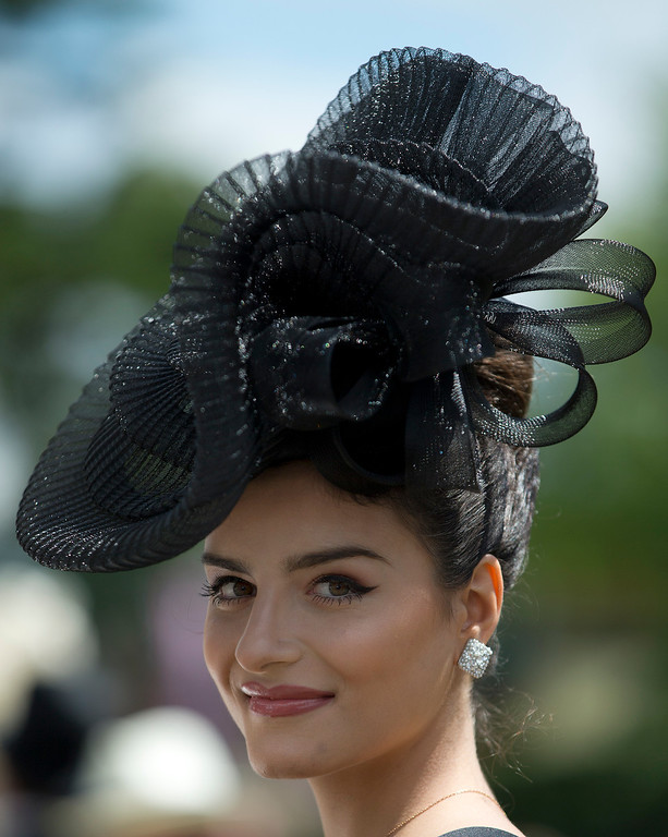. Nicola Kistensen poses for photographers on the second day of the Royal Ascot horse racing meeting at Ascot, England, Wednesday, June, 18, 2014. (AP Photo/Alastair Grant)