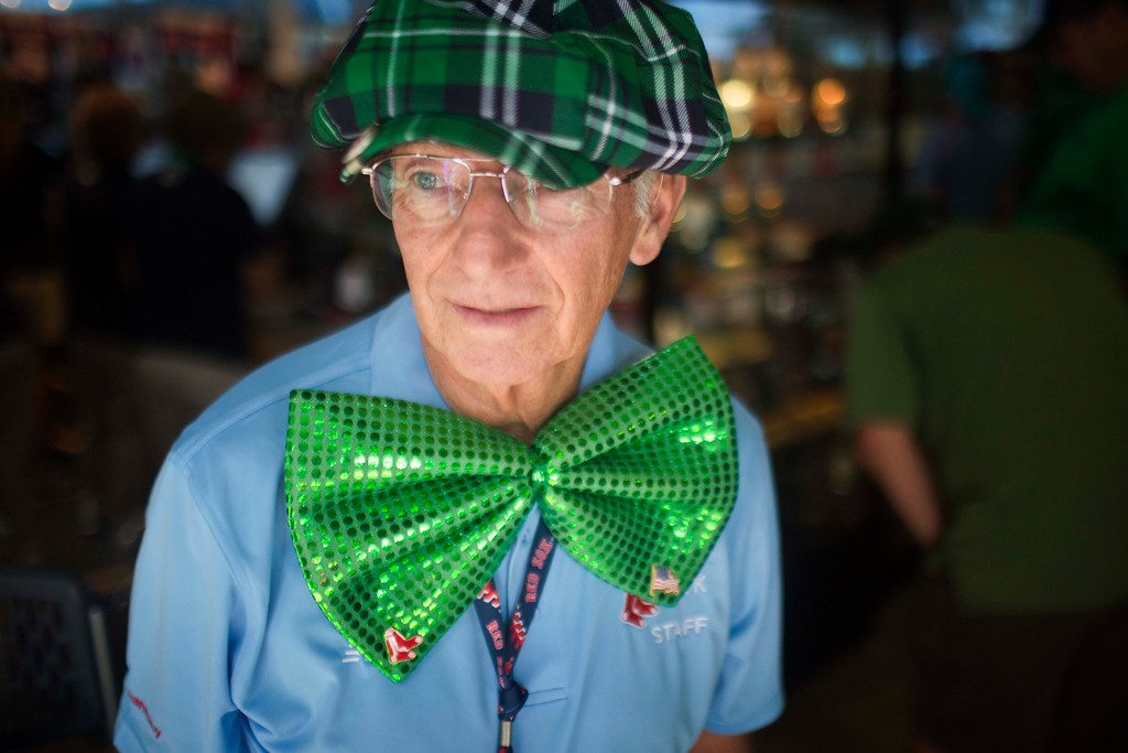 . Boston Red Sox staff member James Comeau shows his St. Patricks day spirit before an exhibition spring training baseball game against the Atlanta Braves, Tuesday, March 17, 2015, in Fort Myers, Fla.  Braves won 11-3. (AP Photo/Brynn Anderson)