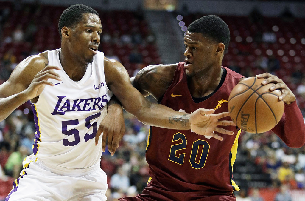 . Cleveland Cavaliers\' Billy Preston, right, drives into Los Angeles Lakers\' Nick King during the first half of an NBA summer league basketball game Monday, July 16, 2018, in Las Vegas. (AP Photo/John Locher)
