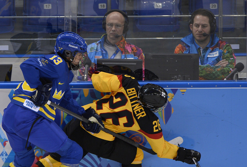. Sweden\'s Lina Wester (L) vies with Germany\'s Monika Bittner during the Women\'s Ice Hockey Group B match Germany vs Sweden at the Shayba Arena during the Sochi Winter Olympics on February 11, 2014.  (JONATHAN NACKSTRAND/AFP/Getty Images)
