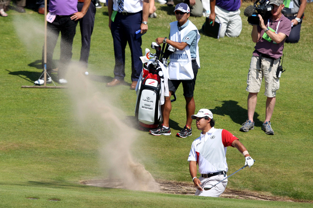 . Japan\'s Hideki Matsuyama plays out of a green-side bunker on the 17th hole during his first round 69, on the opening day of the 2014 British Open Golf Championship at Royal Liverpool Golf Course in Hoylake, north west England on July 17, 2014. (PETER MUHLY/AFP/Getty Images)