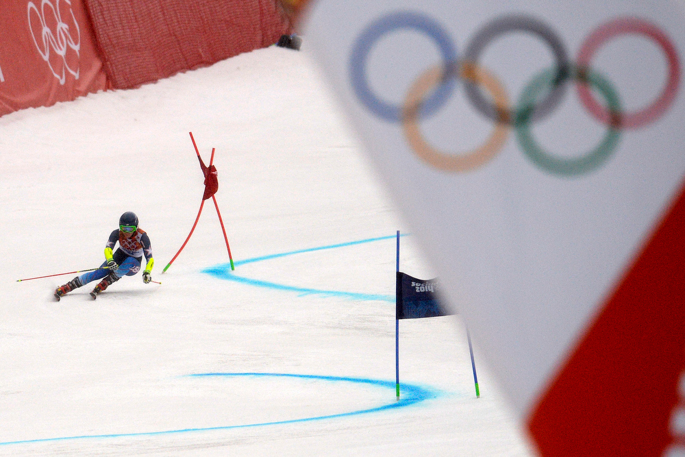 Description of . U.S.A. skier Mikaela Shiffrin races during the first round of the ladies' giant slalom. Sochi 2014 Winter Olympics on Tuesday, February 18, 2014. (Photo by AAron Ontiveroz/The Denver Post)