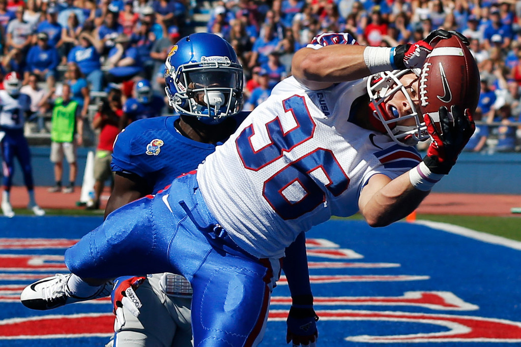 . Louisiana Tech running back Hunter Lee (36) makes a touchdown catch as Kansas safety Isaiah Johnson defends during the first half of an NCAA college football game in Lawrence, Kan., Saturday, Sept. 21, 2013. (AP Photo/Orlin Wagner)