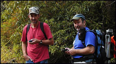 Kenny and Bill ciphering where we iz. Snowbird Mtns NC standing beside Middle Falls.