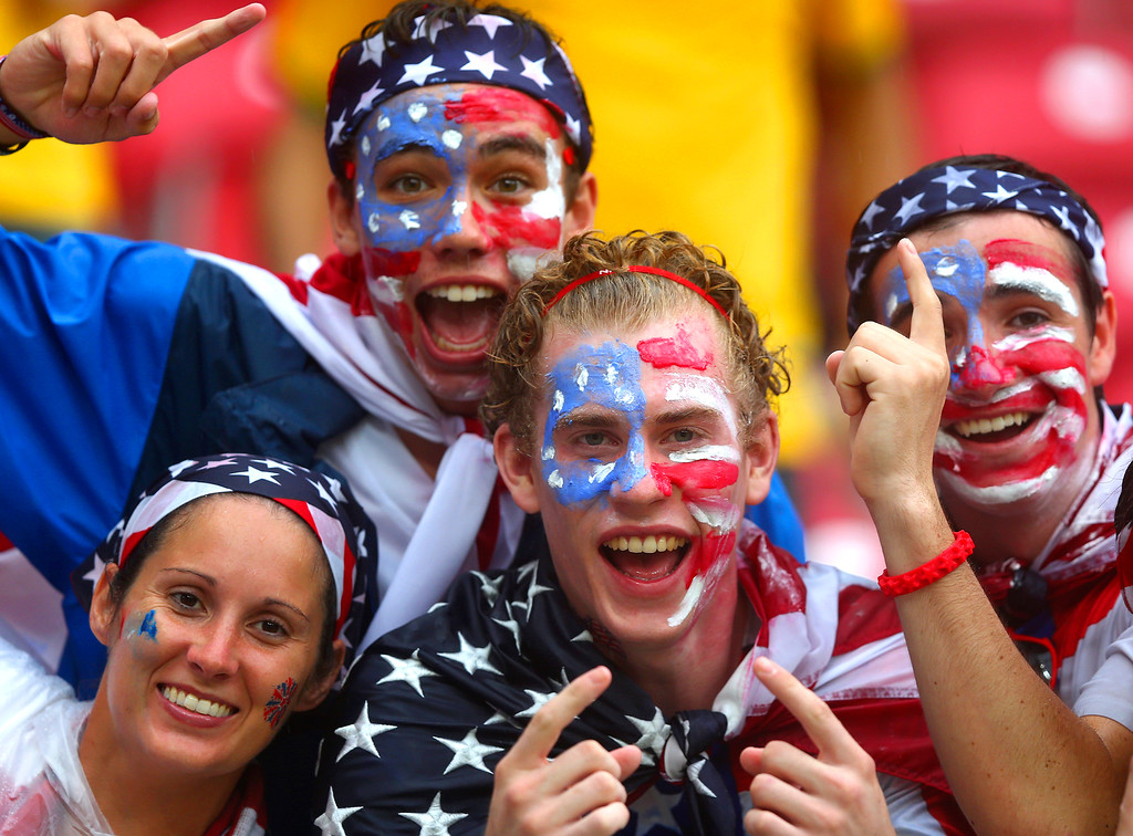 . United States fans cheer in the rain prior to the 2014 FIFA World Cup Brazil group G match between the United States and Germany at Arena Pernambuco on June 26, 2014 in Recife, Brazil.  (Photo by Martin Rose/Getty Images)