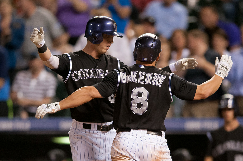 . DENVER, CO - AUGUST 06:  Michael McKenry #8 of the Colorado Rockies celebrates a 2-run home run with Corey Dickerson #6 in the seventh inning of a game against the Chicago Cubs at Coors Field on August 6, 2014 in Denver, Colorado.  (Photo by Dustin Bradford/Getty Images)