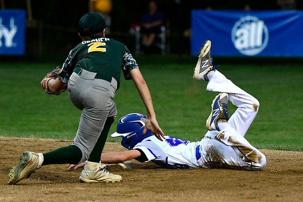 8/10/2018 Mike Orazzi | Staff New Jersey's Leland Ossner (2) tags Maryland's Riley Calloway (48) during the Eastern Regional Little League Tournament at Breen Field in Bristol Friday night.