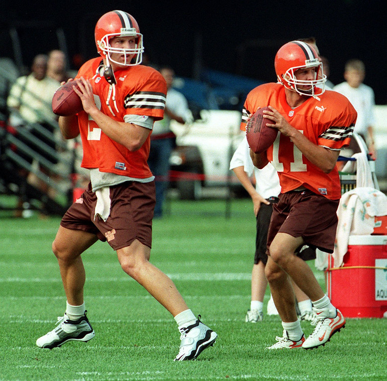 . News-Herald file Cleveland Browns quarterbacks Tim Couch and Ty Detmer work out Thursday in Berea