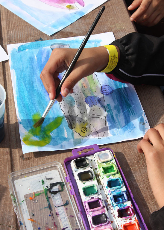 . Azalia Quintero, 9, of Oaklands\' Franklin Elementary School, creates a watercolor of a trout whiie at the Trout in the Classroom program, sponsored by the State Department of Fish and Wildlife, at Shadow Cliffs Regional Recreation Area in Pleasanton, Calif., on Thursday, March 14, 2013. Classes are given 35 trout eggs and tanks. When the hatchlings are large enough they are released into local lakes. About 200 students and teachers released fish at Shadow Cliffs.  (Jim Stevens/Staff)