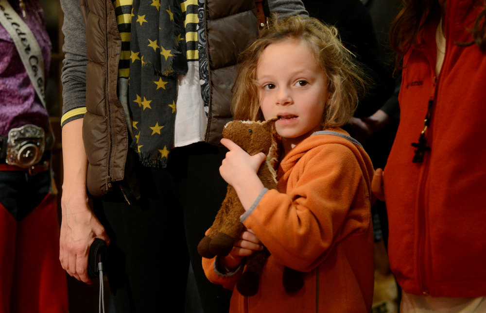 . DENVER, CO. - JANUARY 25:  Natalie Rosenbluth, 8, waits to see the National Western Stock Show\'s Grand Champion and Reserve Steers at the Brown Palace Hotel & Spa in Denver, CO, January, 25, 2013. The Grand Champion ,Trevor, weighing in at 1335 lbs. was raised by Shilo Schaake of Westmoreland, KS. The Reserve Grand Champion, Nick, 1275 lbs, was shown by Jessica Webster of Runnells, IA. (Photo By Craig F. Walker / The Denver Post)