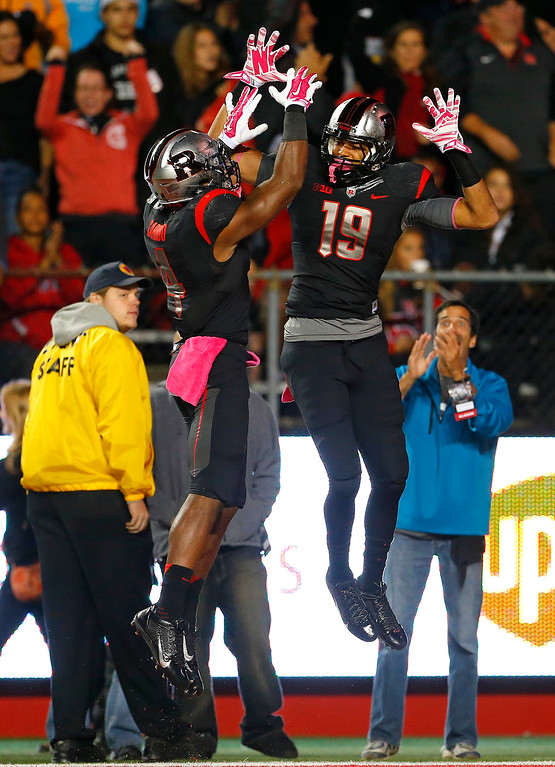 . Rutgers wide receiver Andrew Turzilli (19) celebrates in the end zone with Leonte Carroo (4) after scoring on a reception against Michigan during the first half of an NCAA college football game Saturday, Oct. 4, 2014, in Piscataway, N.J. (AP Photo/Rich Schultz)