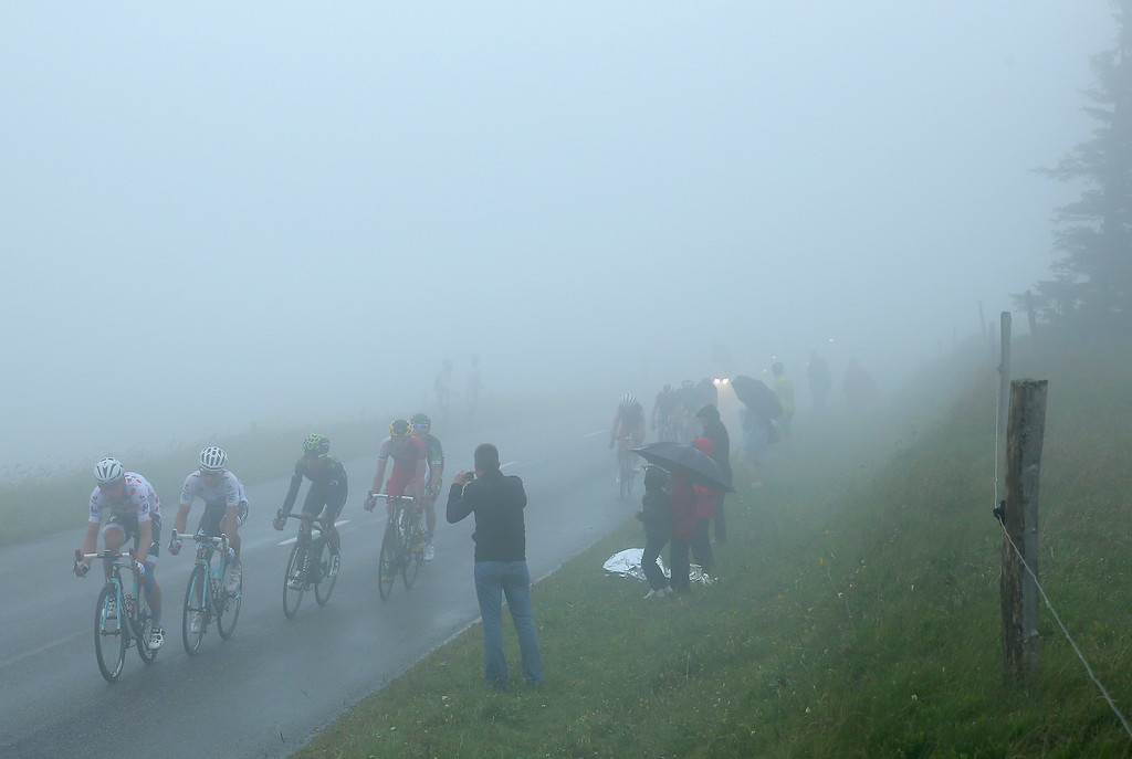 . The breakaway desends the Col du Platzerwasel in heavy fog during stage ten of the 2014 Le Tour de France from Mulhouse to La Planche des Belles Filles on July 14, 2014 in Sondemach, France.  (Photo by Doug Pensinger/Getty Images)