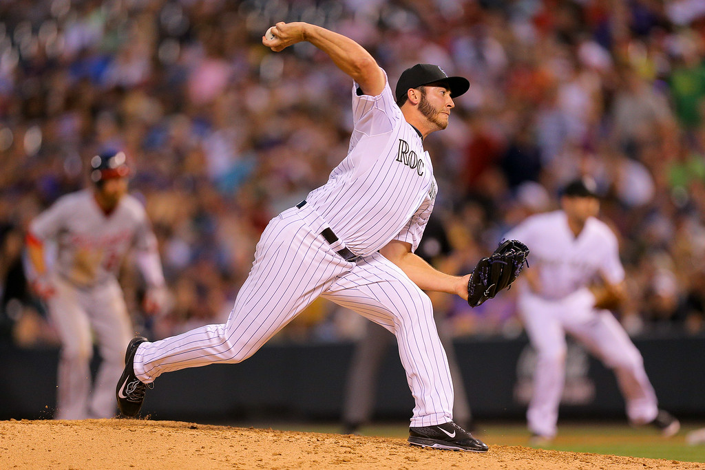 . DENVER, CO - JULY 22:  Relief pitcher Chad Bettis #35 of the Colorado Rockies delivers to home plate during the sixth inning against the Washington Nationals at Coors Field on July 22, 2014 in Denver, Colorado.  (Photo by Justin Edmonds/Getty Images)