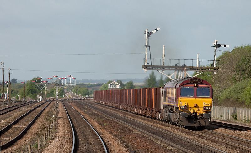 EWS 66063 leads the 6K21 08:06 Santon-Immingham empty iron ore tipplers in Wrawby Junction.