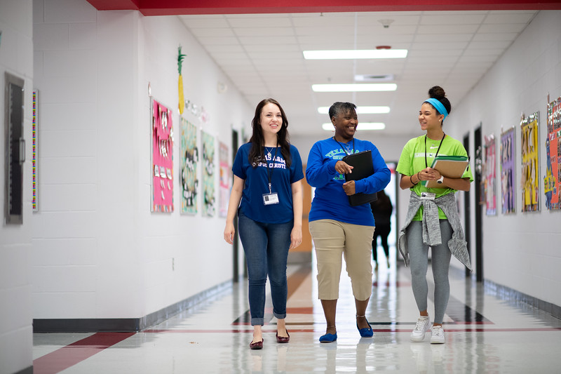 Kaela Mathis (left), Audrey Barnes, and Maddie Woods make their way to the tutoring room made available to them at Kennedy Elementary. The room is utilized to tutor students in literacy instruction.
