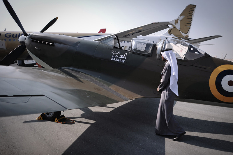 . A Bahraini man looks at airplanes on display during the opening of the Bahrain International Airshow 2014, in Sakhir, south of the capital Manama, on January 16, 2014. (MOHAMMED AL-SHAIKH/AFP/Getty Images)