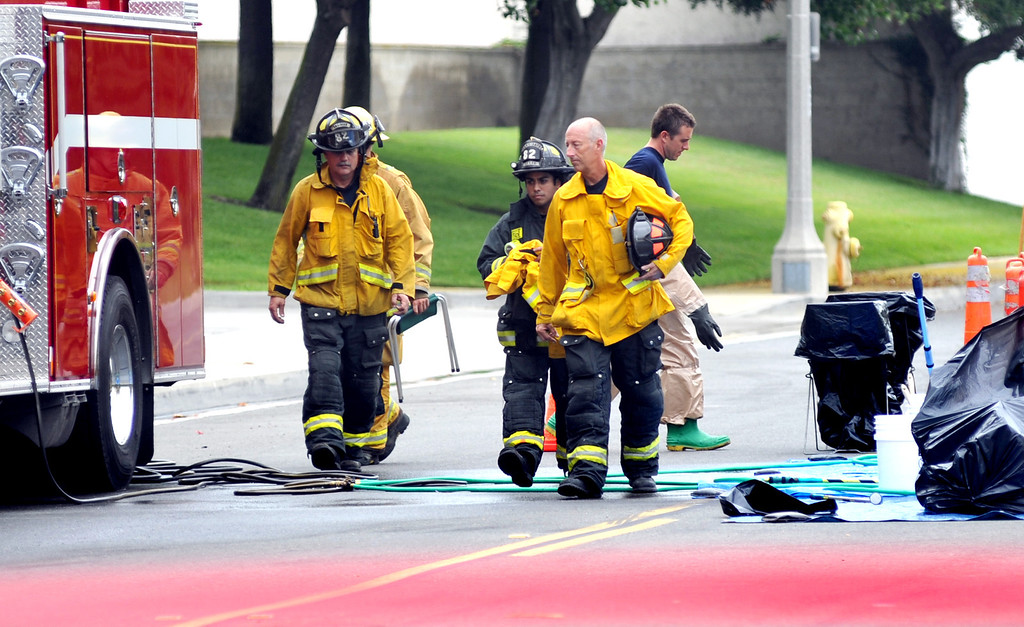 . Santa Fe Springs Hazardous Materials crew members and Firefighters respond to a leaking chemical barrel containing Ethylenediamine that created a cloud at Central Transport on the 12200-block of Clark Street in Santa Fe Springs on Thursday July 11, 2013. Employees were evacuated after the barrel was punctured by a forklift causing at least 50-gallons of the chemical to spill. No injuries were reported in the incident. (SGVN/Staff Photo by Keiht Durflinger)