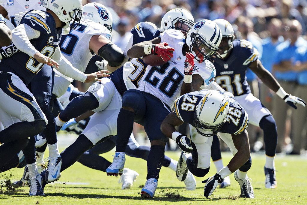 . Chris Johnson #28 of the Tennessee Titans runs the ball against the San Diego Chargers at LP Field on September 22, 2013 in Nashville, Tennessee.  The Titans defeated the Chargers 20-17.  (Photo by Wesley Hitt/Getty Images)