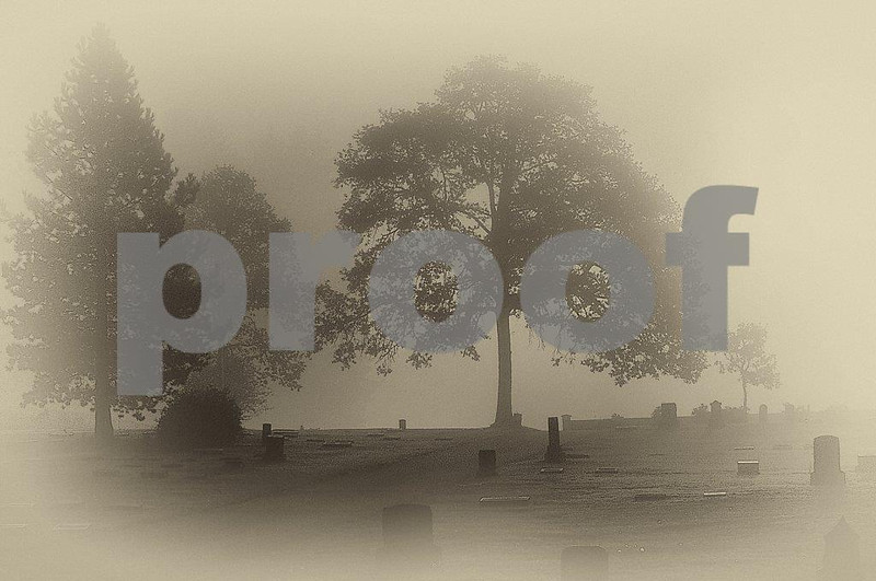 Morning fog hangs over the Pioneer Cemetery in Lacey, WA.