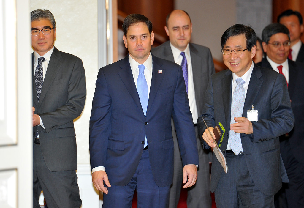 . U.S. Senator Marco Rubio, R-Fla., center, arrives for a meeting with South Korean President Park Geun-hye at the presidential Blue House in Seoul, South Korea Saturday, Jan. 25, 2014. (AP Photo/Jung Yeon-je, Pool)