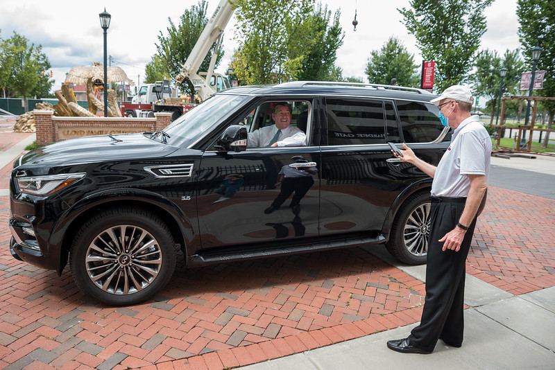 Athletic Director Ray Tanner talks with Kevin O'Connell, outside of Williams-Brice Stadium near an 800 square-foot gamecock sculpture in center of the Lloyd Family Courtyard, on Sept. 10, 2020. John A. Carlos II / Special to The Post and Courier