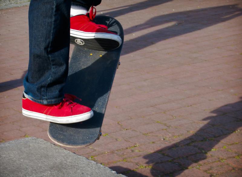 skateboard curb hop
