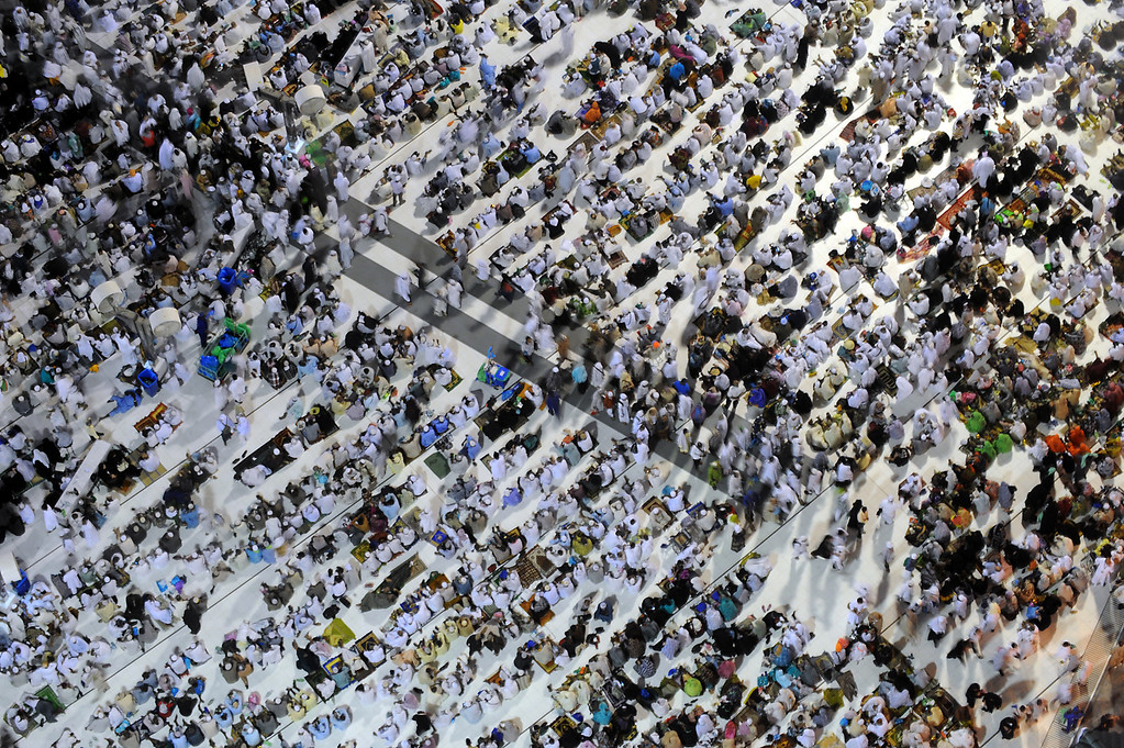 . A general view shows pilgrims performing evening prayers in Mecca\'s Grand Mosque on October 8, 2013, as more than two million Muslims arrive in the holy city for the annual hajj pilgrimage. The hajj, which is one of the world\'s largest human assembly, begins on October 13 amid concerns over the deadly MERS coronavirus. (FAYEZ NURELDINE/AFP/Getty Images)