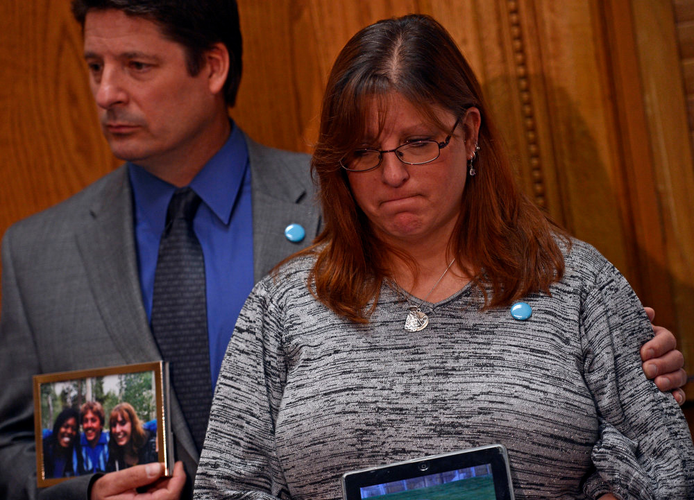 . Dave and Theresa Hoover, mother of Aurora victim AJ Boik, speak to media before testifying, March, 04, 2013, at the Colorado State Capitol. The two are in support of stronger gun laws in Colorado. (Photo By RJ Sangosti/The Denver Post)