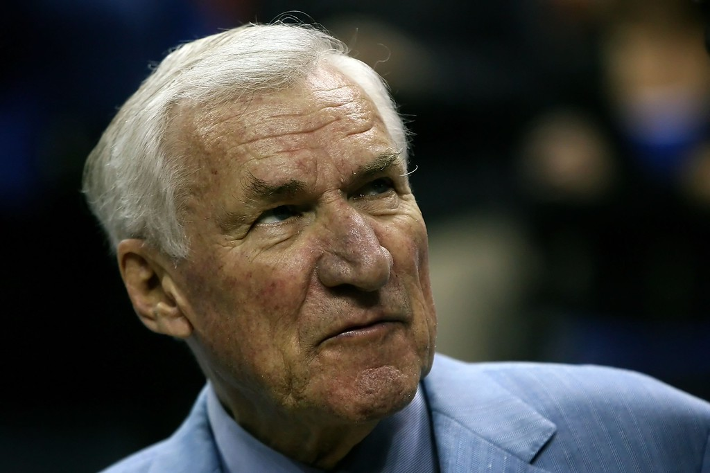 . FILE - FEBRUARY 8:  According to reports February 8, 2015, former North Carolina Tar Heels basketball coach Dean Smith has died at the age of 83. CHARLOTTE, NC - MARCH 15:  Former North Carolina Tar Heels head coach Dean Smith attends a halftime ceremony honoring ACC legends at the Virginia Tech Hokies and Tar Heels game at the 2008 Men\'s ACC Basketball Tournament at Bobcats Arena on March 15, 2008 in Charlotte, North Carolina.  (Photo by Kevin C. Cox/Getty Images)
