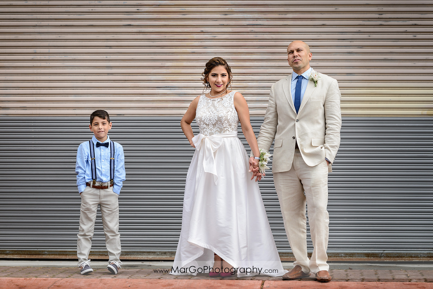 bride, groom and ring bearer on the street in Martinez, CA