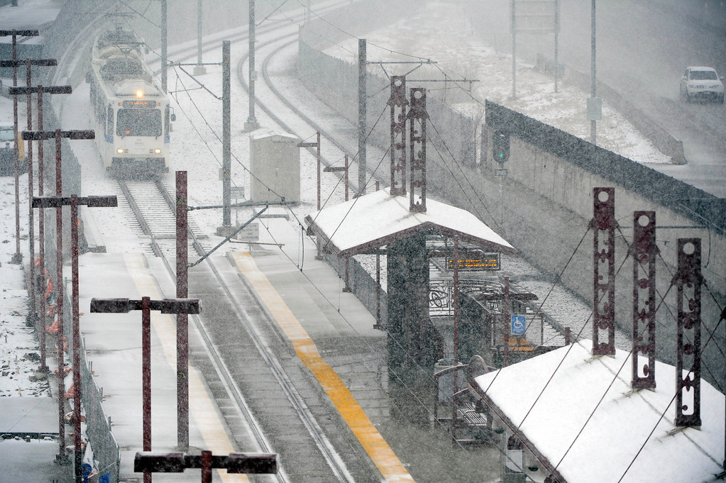 . DENVER, CO. - MARCH 9TH: An RTD light rail car makes it\'s way into the University of Denver station in steady snowfall Saturday morning, March 9th, 2013. (Photo By Andy Cross/The Denver Post)