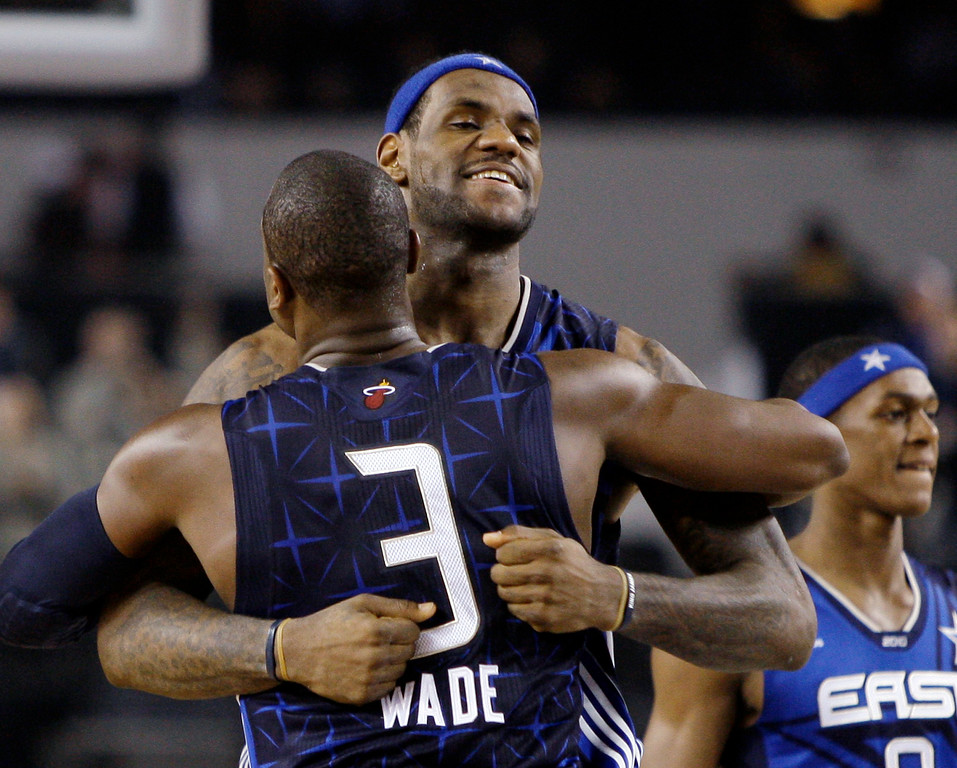 . East All-Star LeBron James of the Cleveland Cavaliers hugs Dwyane Wade of the Miami Heat after the East beat the West 141-139 in the NBA All-Star basketball game Sunday, Feb. 14, 2010, at Cowboys Stadium in Arlington, Texas. Wade was named MVP of the game. (AP Photo/LM Otero)