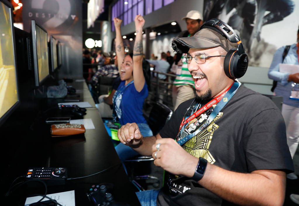 ". IMAGE DISTRIBUTED FOR ACTIVISION - Fans, Michelle Torres, left, and Ray Gomez visit Activision\'s ""Destiny 2\"" booth during E3 2017 at the Los Angeles Convention Center on Tuesday, June 13, 2017, in Los Angeles, Calif. (Photo by Colin Young-Wolff/Invision for Activision/AP Images)"